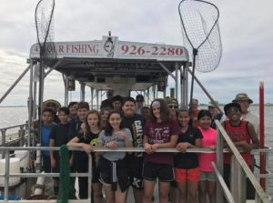 Sixth grade students prepare to embark on an educational trawling trip with their teachers and biologists aboard the Duke O Fluke charter vessel in Somers Point.